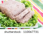 pate of pork with fresh lettuce on a plate - stock photo