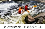 young persons rafting on the... | Shutterstock . vector #1100697131