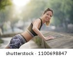 athletic woman stretching out... | Shutterstock . vector #1100698847