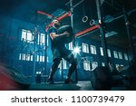 fit young man lifting barbells... | Shutterstock . vector #1100739479
