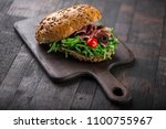tasty sandwich with rucola and... | Shutterstock . vector #1100755967