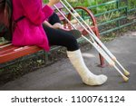 unrecognizable girl sits on the ... | Shutterstock . vector #1100761124