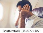 male passenger having ear pop... | Shutterstock . vector #1100773127