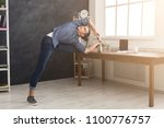short break for yoga in office. ... | Shutterstock . vector #1100776757