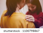 women are praying with hands on ... | Shutterstock . vector #1100798867