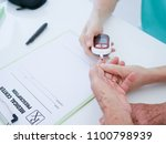 elderly woman with blood... | Shutterstock . vector #1100798939