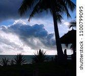 storm cloud stock images. beach ... | Shutterstock . vector #1100799095