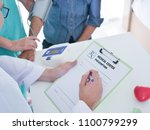 elderly woman meeting doctor in ... | Shutterstock . vector #1100799299