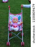 Small photo of A doll pram with a doll