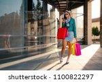 attractive girl walking with... | Shutterstock . vector #1100822297