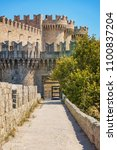 city walls and entrance to... | Shutterstock . vector #1100837204