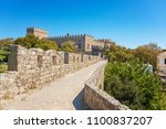 city walls and entrance to... | Shutterstock . vector #1100837207