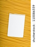 Note paper on Italian pasta background - stock photo