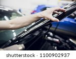 worker hands installs car paint ... | Shutterstock . vector #1100902937