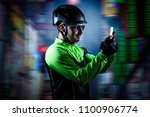 young cyclist looking... | Shutterstock . vector #1100906774