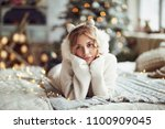 young sensual blonde in sweater ... | Shutterstock . vector #1100909045