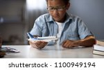 boy dreaming of becoming pilot...   Shutterstock . vector #1100949194