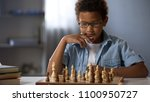 concentrated boy developing... | Shutterstock . vector #1100950727