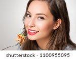 beautiful young brunette woman... | Shutterstock . vector #1100955095