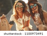 two female friends hangout at... | Shutterstock . vector #1100973491