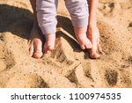parent and child walking... | Shutterstock . vector #1100974535