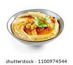 bowl of hummus isolated on... | Shutterstock . vector #1100974544