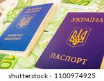 two ukrainian passports on euro ... | Shutterstock . vector #1100974925