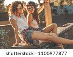 two female skaters best friends ... | Shutterstock . vector #1100977877