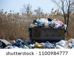 Small photo of The garbage can is packed with garbage and waste. Untimely remov