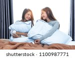 two asian lesbian women looking ... | Shutterstock . vector #1100987771