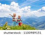 children hiking in alps...   Shutterstock . vector #1100989151