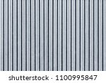 white corrugated metal fence... | Shutterstock . vector #1100995847