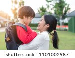 mom hug and carry her son.... | Shutterstock . vector #1101002987