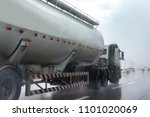 Small photo of Gas Truck on highway road with tank oil container, transportation concept.,import,export logistic industrial Transporting Land transport on rain is falling on the asphalt road.
