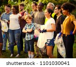 volunteers picking trash at a... | Shutterstock . vector #1101030041
