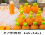 cold orange juice in a bottle... | Shutterstock . vector #1101051671