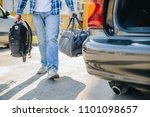 young adult man putting bag in... | Shutterstock . vector #1101098657