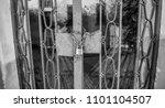 locker and chain closing a gate. | Shutterstock . vector #1101104507