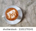 Stock photo morning coffee latte in cafe and restaurant coffee cup with cute puppy art drawing on the top of 1101170141
