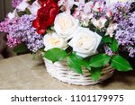 bouquet of lilacs and red... | Shutterstock . vector #1101179975
