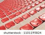 empty plastic red seats on... | Shutterstock . vector #1101195824