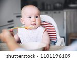 feeding. messy smiling baby... | Shutterstock . vector #1101196109