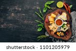 assorted cheeses. cheese plate. ... | Shutterstock . vector #1101205979