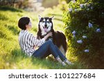 cute girl with her dog outside | Shutterstock . vector #1101227684