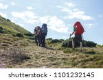 back view of three hikers with... | Shutterstock . vector #1101232145