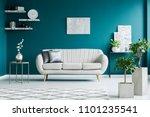 white sofa between a metal... | Shutterstock . vector #1101235541
