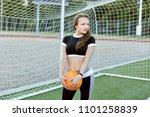 young woman stands near a... | Shutterstock . vector #1101258839