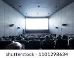 Crowd Audience In Dark Looking...
