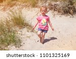 little  girl l at the beach... | Shutterstock . vector #1101325169