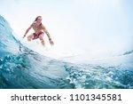 young surfer rides an ocean... | Shutterstock . vector #1101345581